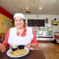 Xinia's Bakery, Xinia Cruz, owner with pupusas